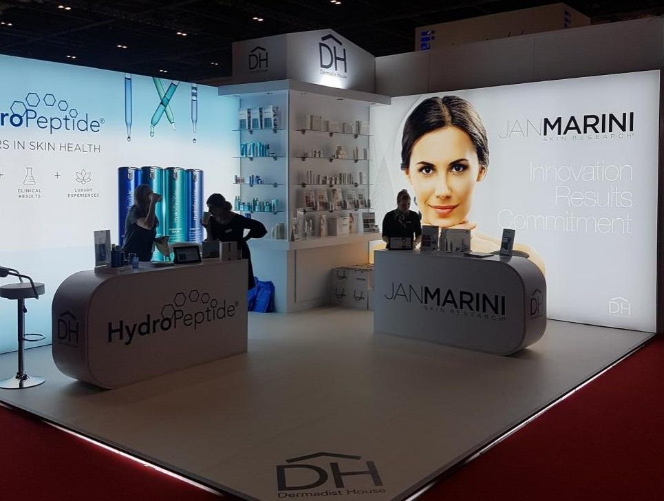 Jan Marini and Hydro Peptide lightbox exhibition stand