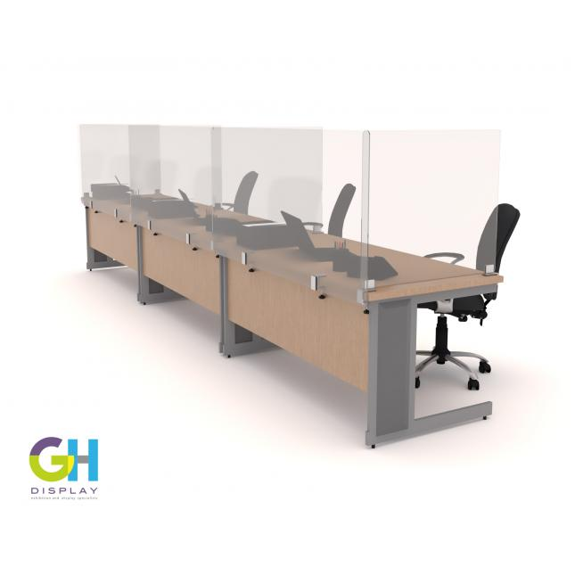Row of protective screens on office desks